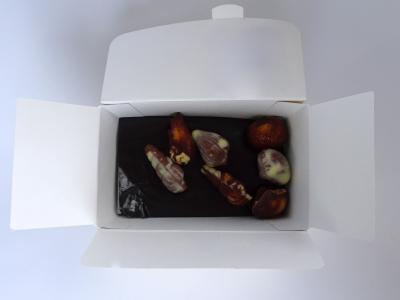 White cristal paper in a chocolate box