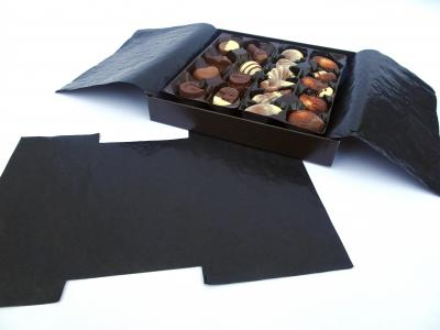 Black cristal paper inside of a chocolate box