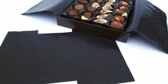 Black cristal paper in a chocolate box